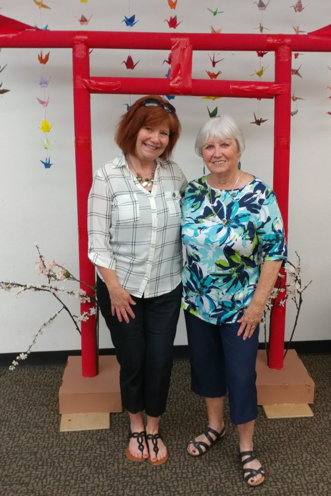 Denise Nordell stands on the left, with Pat Glatkke on the right.