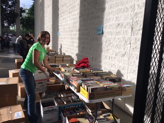 Friends member Ellen Dambrosio sets out fiction books before the sale opens.