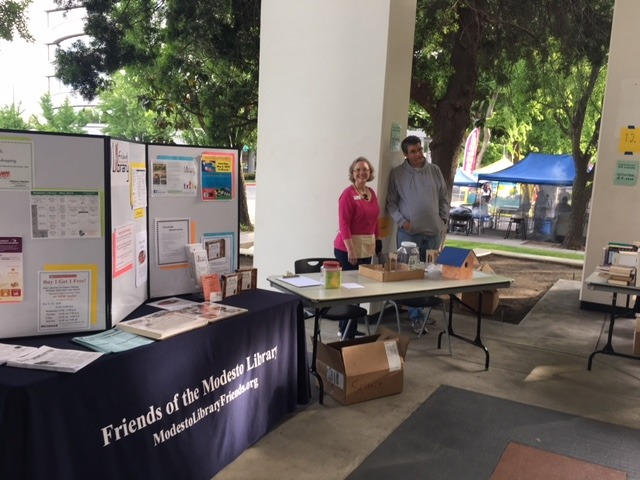 Anne Britton and Mike Leamy are ready to share information about the Friends with shoppers.