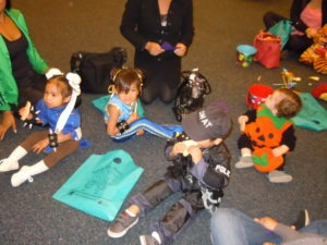 costumed children eating cookies after Halloween parade