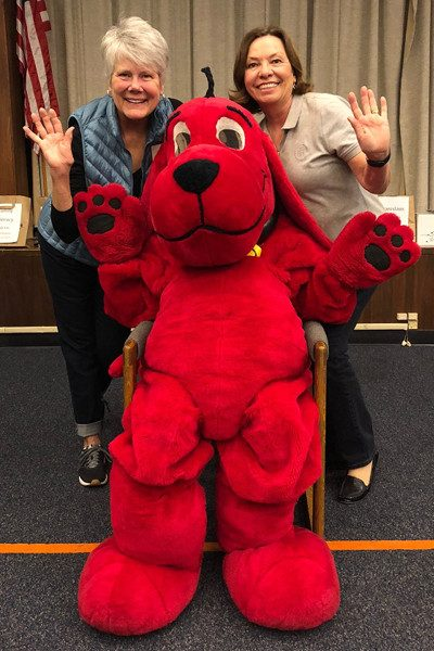 Friends Anna Seidel and Marilyn Drew wave with Clifford.