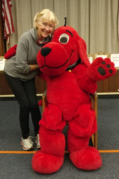 Frirend Sue Conner spends a moment with Clifford.
