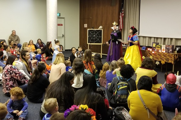 170 children and their families listened as staff from the children's department presented the day's stories. The Wicked Witch is Christin Hutsell and Snow White is Elisa McDaniel.