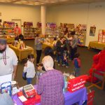 Volunteers sell books during Clifford's visit