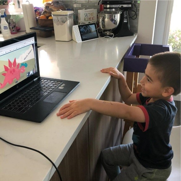 grandson watches eBook while Grandma reads