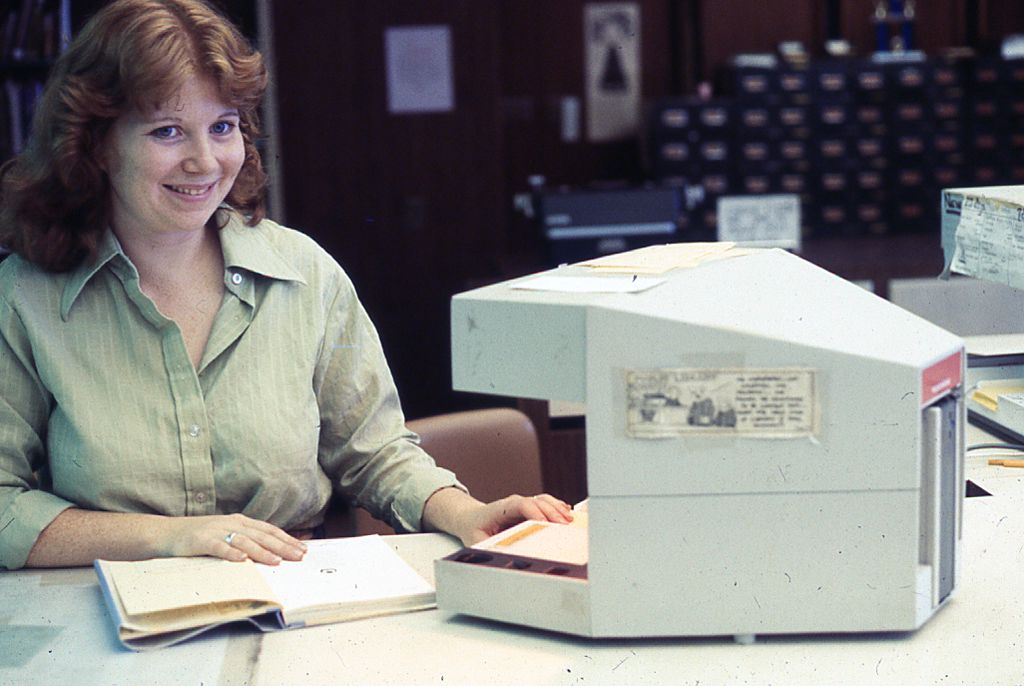 Denise checking out books at circulation desk