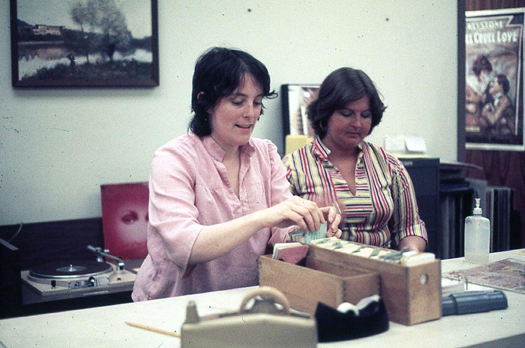 2 women work at audiovisual desk
