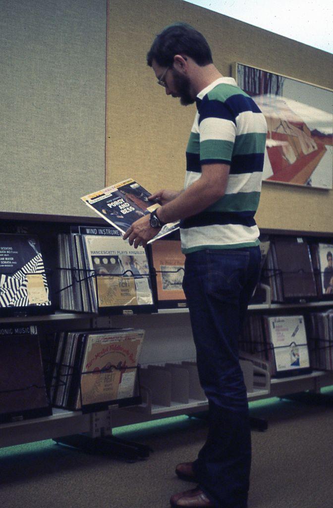 man looks at an LP