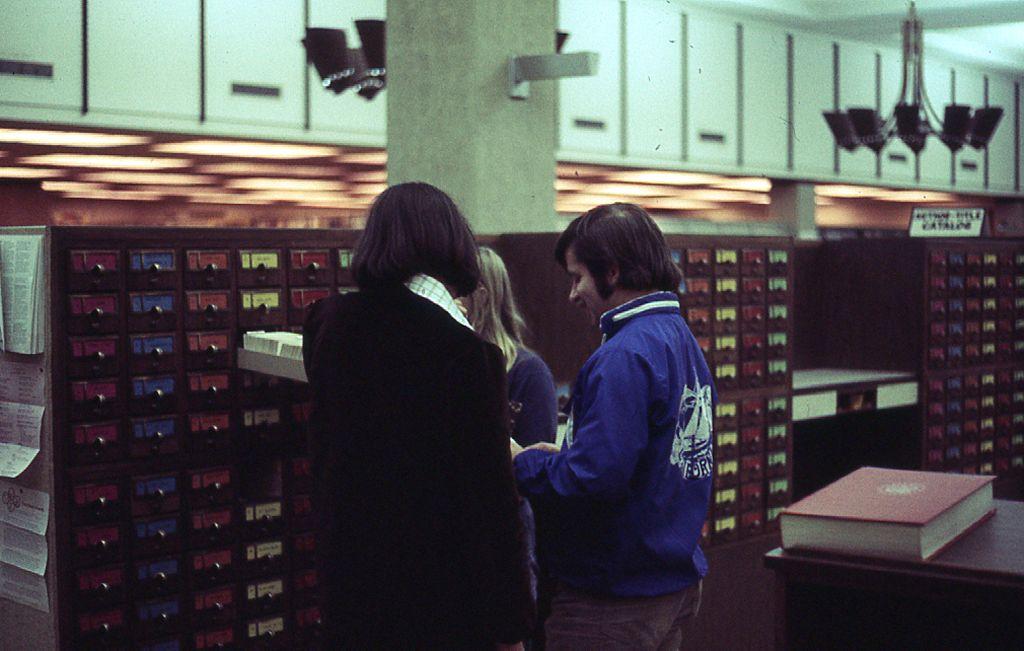 three people using card catalog